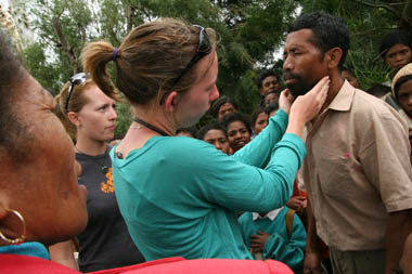 A medical volunteer consults patients in the rural village of Hatubilico